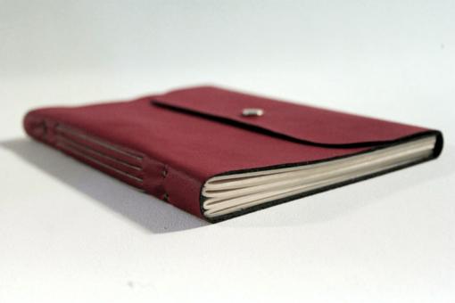 caderno-vermelho-desenho-costura-longstitch