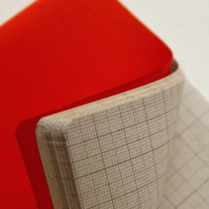 detalhe caderno miolo milimetrado papel reciclado